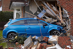 © Licensed to London News Pictures.  12/09/2011. Aylesbury, UK. A blue Vauxhall Astra remains lodged in the front of a house in Aylesbury, Buckinghamshire after failing to negotiate a nearby roundabout on Saturday night. The car was thought to be travelling in excess of 80 mph when the accident occurred and the occupants of the house were lucky to be unhurt. Photo credit :  Cliff Hide/LNP