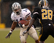 Kansas State running back Leon Patton (14) rushes up field against pressure from Missouri defensive back Hardy Ricks (28) for a first down at Faurot Field in Columbia, Missouri, October 21, 2006.  The Tigers beat the Wildcats 41-21.<br />