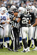 An NFL official breaks up a fight during the Oakland Raiders NFL week 16 football game against the Indianapolis Colts on Sunday, December 26, 2010 in Oakland, California. The Colts won the game 31-26. (©Paul Anthony Spinelli)