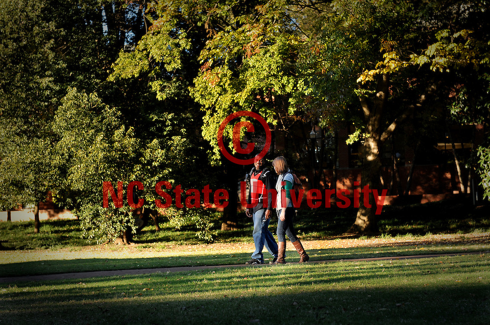 NCSU students walk across the Court of Carolinas on a sunny fall afternoon. Photo by Becky Kirkland