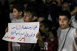 October 2, 2018 - Idleb, Syria North, Syria - A child seen holding a placard during the demonstration..Thousands of demonstrators took to the street during an evening demonstration in Idlib City demanding freedom for protocol prisoners imprisoned by the Syrian regime. They are also shouting anti regime slogans and demanding president Assad to step down. (Credit Image: © Muhmmad Al-Najjar/SOPA Images via ZUMA Wire)