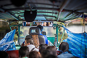 14 NOVEMBER 2012 - BANGKOK, THAILAND:  A driver reflected in the rear view mirror of a passenger boat on Khlong Saen Saeb in Bangkok. Bangkok used to be criss crossed by canals (called Khlongs in Thai) but most have been filled in and paved over. Khlong Saen Saeb is one of the few remaining khlongs in Bangkok with regular passenger boat service. Boats and ships play an important in daily life in Bangkok. Thousands of people commute to work daily on the Chao Phraya Express Boats and fast boats that ply Khlong Saen Saeb. Boats are used to haul commodities through the city to deep water ports for export.      PHOTO BY JACK KURTZ