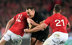 Israel Dagg of New Zealand, centre, crashes into Owen Farrell of the Lions, left and Rhys Webb of the Lions in the third International rugby test match between the the New Zealand All Blacks and British and Irish Lions at Eden Park, Auckland, New Zealand, Saturday, July 08, 2017. Credit:SNPA / Ross Setford  **NO ARCHIVING""