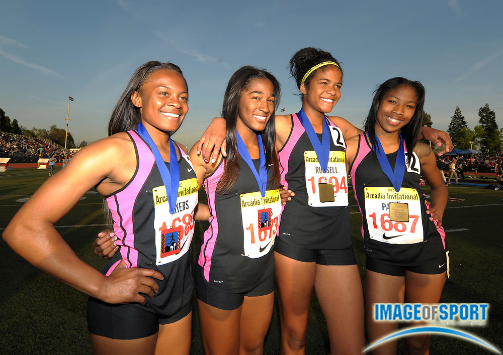 Apr 6, 2012; Arcadia, CA, USA; Members of the Long Beach Poly girls 4 x 100m shuttle hurdle relay pose after winning in 58.11 in the Arcadia Invitational at Arcadia High. From left: Tori Myers and Traci Hicks and Tierney Russell and Kymber Payne.