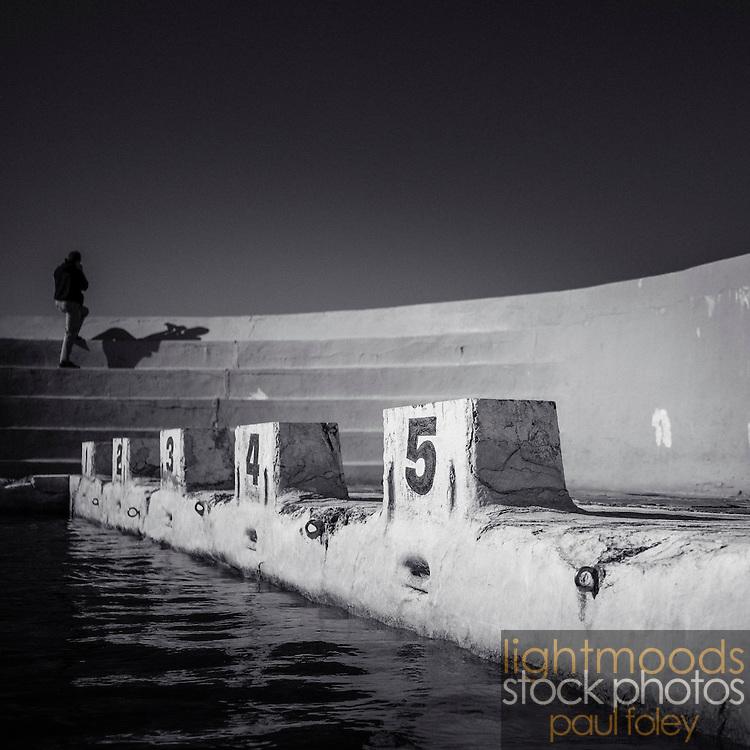 Photographer at Ocean Baths, Newcastle, NSW, Australia.
