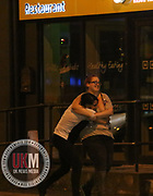 Manchester UK  24.12.2016: Images from Manchesters Gay Village during the Mad Friday celebrations this on the 23 and 24th of December,<br /> <br /> <br /> Friends hug