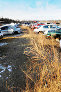 Junk yard in winter with blue sky