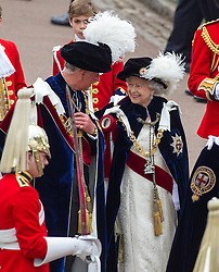 WINDSOR- UK -17 JUNE- 2013:  Members of the British Royal Family attend the annual Garter Ceremony at Windsor Castle in Berkshire for the annual Garter Ceremony and Service in St George's Chapel. Members of The Oder of the Garter process down from the Castle to the Chapel and then return in open carriages.