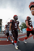 KELOWNA, BC - AUGUST 17:  Keiran Carter #5 of Okanagan Sun walks to the field against the Westshore Rebels  at the Apple Bowl on August 17, 2019 in Kelowna, Canada. (Photo by Marissa Baecker/Shoot the Breeze)