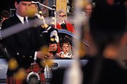 A young boy looks out from a parked car to watch a passing Scottish pipe band, on 18th August 1993, in Campbeltown, Scotland, UK.