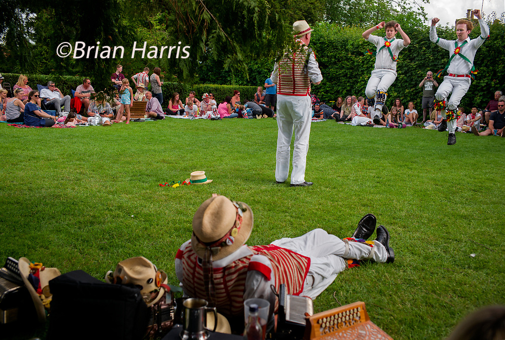 Thaxted Morris Weekend 2-3 June 2018<br /> Thaxted Morris and Country Dancing in Margaret Street Gardens after the main weekend dancing had finished.<br /> Brothers Matt Simons and Ollie Simons from the Cambridge Morris Side dance high kicks in the traditional 'Princess Royal from Bampton' music.