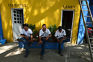 Members of self defense force rest in the town of Buenavista as many gather to battle the brutal Knights Templar drug cartel. Locals who had been operating independently in their own towns are increasingly working together.