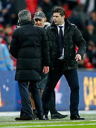Chelsea Manager Jose Mourinho is congratulated by Tottenham Hotspur Manager Mauricio Pochettino at the final whistle after winning the Capital One Cup Final - Photo mandatory by-line: Rogan Thomson/JMP - 07966 386802 - 01/03/2015 - SPORT - FOOTBALL - London, England - Wembley Stadium - Chelsea v Tottenham Hotspur - Capital One Cup Final.
