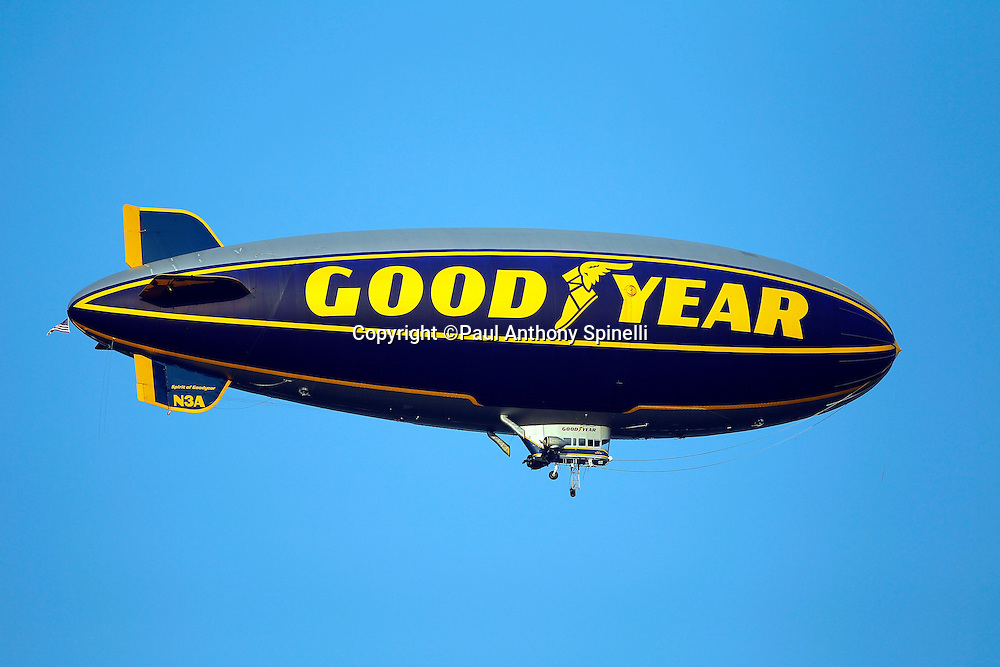 The Goodyear blimp flies over the field during the NFL Pro Football Hall of Fame preseason football game between the Dallas Cowboys and the Cincinnati Bengals on Sunday, August 8, 2010 in Canton, Ohio. The Cowboys won the game 16-7. (©Paul Anthony Spinelli)