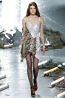 Kia Low (NEXT) walks the runway wearing Rodarte Fall 2015 during Mercedes-Benz Fashion Week in New York on February 17, 2015