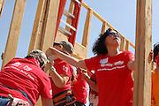 Habitat for Humanity Tucson volunteers raising walls on a new house.