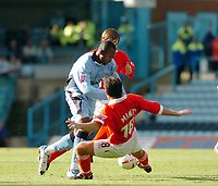 Photo. Leigh Quinnell.  Coventry City v Rotherham United. Coca Cola championship. 18/09/2004.<br /> Stern john looks for a way past Rotherhams Scott Minto