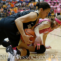 Colorado's Haley Smith, front, and Oregon State's Sydney Wiese, rear, fight for a loose ball in the first half of an NCAA college basketball game in Corvallis, Ore., on Friday, Feb. 12, 2016. (AP Photo/Timothy J. Gonzalez)