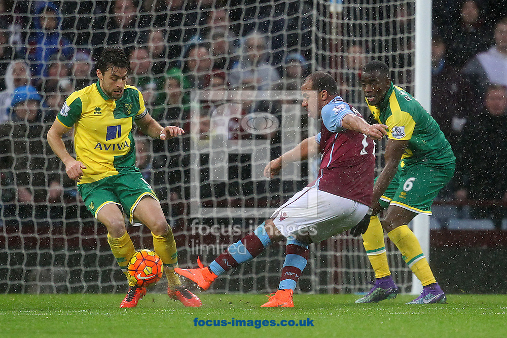 Gabriel Agbonlahor of Aston Villa has a shot on goal that is blocked by Russell Martin of Norwich during the Barclays Premier League match at Villa Park, Birmingham<br /> Picture by Paul Chesterton/Focus Images Ltd +44 7904 640267<br /> 06/02/2016