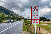 """Regarding the """"NO FREEDOM CAMPING ZONE"""" sign: Freedom camping in New Zealand is when you camp on public land that isn't a recognized camping ground. You can only camp in designated Freedom Camping Zones if you are certified self-contained. From Makarora, Wilkin River Jets carried us 3km via jetboat up the Makarora River to Young River confluence to begin tramping the Gillespie Pass Circuit, in Mount Aspiring National Park, Southern Alps, Otago region, South Island of New Zealand. After 4 days, they picked us up at Kerin Forks on Wilkin River."""