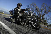 Bill Dragoo on 2008 BMW R1200 GS Adventure riding a twisty road outside San Jose, CA