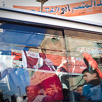 A man on a bus looks at supporters of Abdel Moneim Aboul Fotouh, a former Brotherhood leader running for president, at a campaign event  in Abu Kabir, Egypt, Friday, May 11, 2012. May 2012.