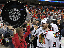 June 9, 2010; Philiadelphia, PA; USA;  Chicago Blackhawks defenseman Duncan Keith (2) celebrates with family after the Blackhawks defeated the Flyers 4-3 in Game 6 of the Stanley Cup Finals at the Wachovia Center.