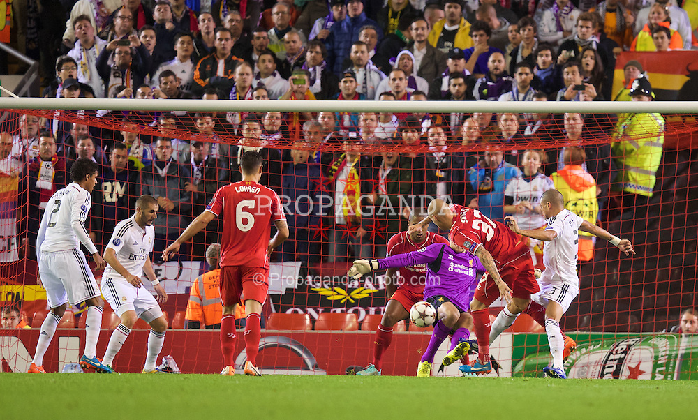 LIVERPOOL, ENGLAND - Wednesday, October 22, 2014: Liverpool's Martin Skrtel and goalkeeper Simon Mignolet clash as Real Madrid CF's Karim Benzema scores the third goal during the UEFA Champions League Group B match at Anfield. (Pic by David Rawcliffe/Propaganda)