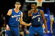 Feb. 13, 2011; Cleveland, OH, USA; Washington Wizards guard Kirk Hinrich (12) and point guard John Wall (2) talk during the fourth quarter against the Cleveland Cavaliers at Quicken Loans Arena. The Wizards beat the Cavaliers 107-93 for their first win on the road this season. Mandatory Credit: Jason Miller-US PRESSWIRE