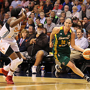 Sue Bird, (right), Seattle Storm, drives to the basket defended by Chiney Ogwumike, Connecticut Sun, during the Connecticut Sun Vs Seattle Storm WNBA regular season game at Mohegan Sun Arena, Uncasville, Connecticut, USA. 23rd May 2014. Photo Tim Clayton