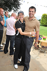 KENNY & GABBY LOGAN at the Mini Masters Golf tournament in aid of LEUKA - London's celebrity golf tournament held at Duke's Meadow Golf Club, Dan Mason Drive, London W4 on 17th July 2009.