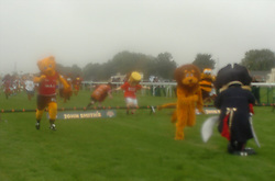 LEADER LEO THE LION (HUNTINGDON  LEISURE CENTRE) IS BLOCKED BY CAPTAIN BLADE (Sheffield Utd) for WACKY MACKY (Saffron Walden FC),TO PASS AND  TO WIN THE RACE, John Smiths Mascot Grand National, Huntingdon Racecourse Sunday 5th October 2008