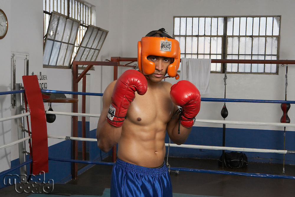 Portrait of man in boxing ring