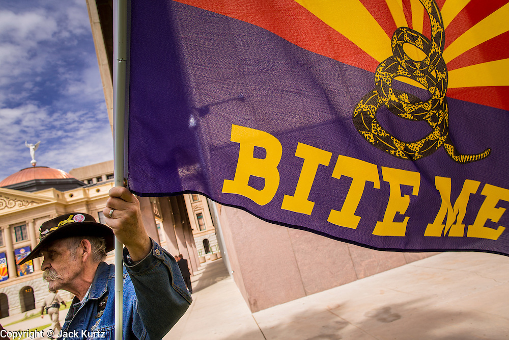 25 APRIL 2012 - PHOENIX, AZ: MIKE KEATING, a member of the Tea Party, stands in front of the Arizona state capitol Wednesday. Immigrants' rights groups opposed to SB1070 and Tea Party affiliated groups that support SB1070 gathered at the state capitol in Phoenix Wednesday to express their opposition and support of the bill. SB1070 was signed by Arizona Governor Jan Brewer in April 2010. At the time it was the toughest anti-illegal immigration bill in the country. Immigrants' rights groups sued Arizona and the federal courts stopped enforcement of the bill. The bill ended up in the US Supreme Court which heard arguments Wednesday. A ruling on the bill is expected in June.     PHOTO BY JACK KURTZ