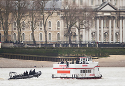 © Licensed to London News Pictures.19/03/2017.London, UK. Armed police take control of a cruise boat as it passes the Old Royal Naval College in Greenwich during an ant-terrorist training exercise on The River Thames in London. It is the first time that an exercise of this type has taken place on the river.Photo credit: Peter Macdiarmid/LNP