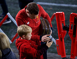 SWANSEA, WALES - Monday, January 22, 2018: Liverpool's James Milner helps a young supporter take a selfie before the FA Premier League match between Swansea City FC and Liverpool FC at the Liberty Stadium. (Pic by David Rawcliffe/Propaganda)
