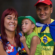 Portrait of Brazilian family from Bahia showing their ethnic and cultural pride during the Lavagem da Rua 46 in NYC.