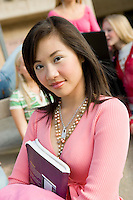 Student Holding Book Heading to Class