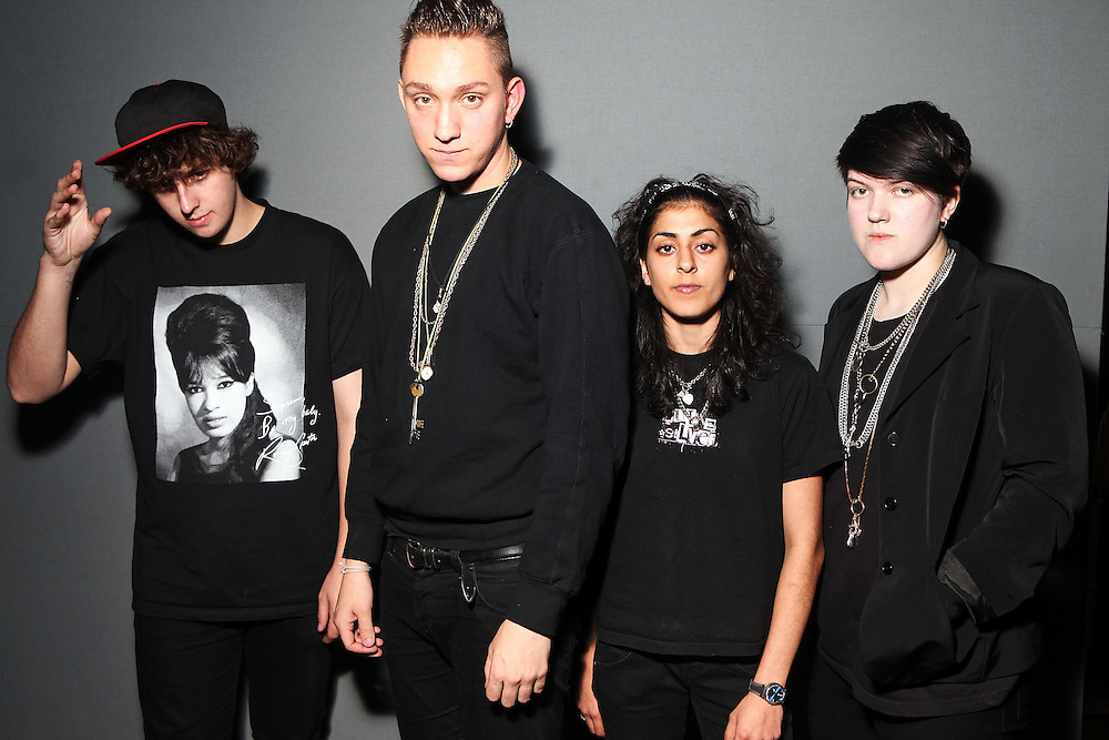 NEW YORK - OCTOBER 22:  (L to R) Jamie Smith, Oliver Sim, Baria Qureshi.and Romy Madley-Croft of the xx pose for a portrait backstage at the Apple Store Soho on October 22, 2009 in New York City.  (Photo by Roger Kisby/Getty Images)