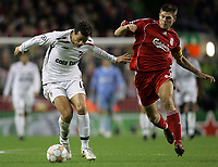 Photo: Paul Thomas/Sportsbeat Images.<br /> Liverpool v Besiktas. UEFA Champions League. 06/11/2007.<br /> <br /> Bobo (L) of Besiktas is chased down by Steven Gerrard.