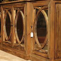 A 81 inch Mirror, 4 Door Buffet, in the Harris Wholesale Furniture showroom.