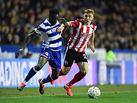 Football - 2019 / 2020 Emirates FA Cup - Fifth Round: Reading vs. Sheffield United<br /> <br /> Reading's Andy Yiadom holds off the challenge from Sheffield United's Ben Osborn, at the Madejski Stadium.<br /> <br /> COLORSPORT/ASHLEY WESTERN