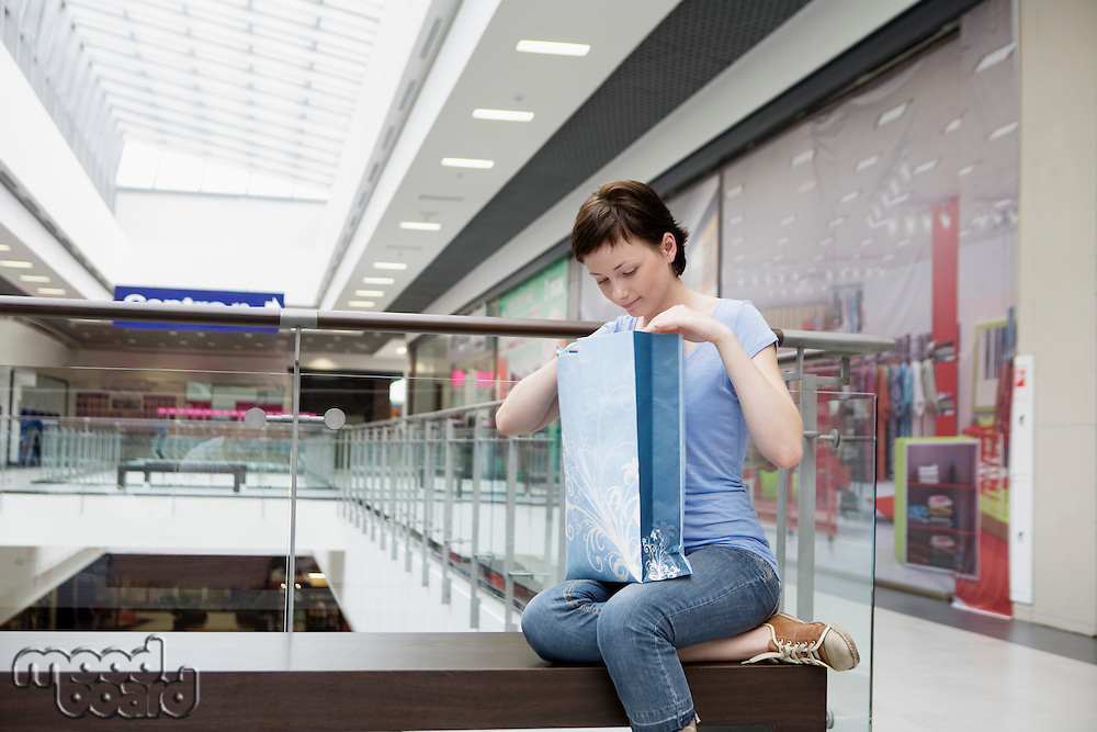 Young woman sits in new Voronezh shopping centre