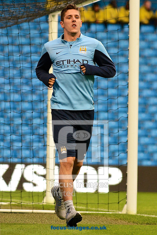 Picture by Ian Wadkins/Focus Images Ltd +44 7877 568959<br /> 26/12/2013<br /> Stevan Jovetic of Manchester City runs around the pitch to assesses his fitness with a Manchester City coach ahead of the Barclays Premier League match at the Etihad Stadium, Manchester.