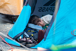 © Licensed to London News Pictures. 17/07/2019. Leeds, UK. An activist sleeps in her tent this morning as the Extinction Rebellion protest enters its third day in Leeds where activist's have blocked Victoria Bridge in the city centre with a boat & tents. The protest is part of Extinction Rebellion's 'summer uprising' campaign, which has seen similar blockades in London, Cardiff, Bristol and Glasgow & is expected to last until Friday. Photo credit: Andrew McCaren/LNP