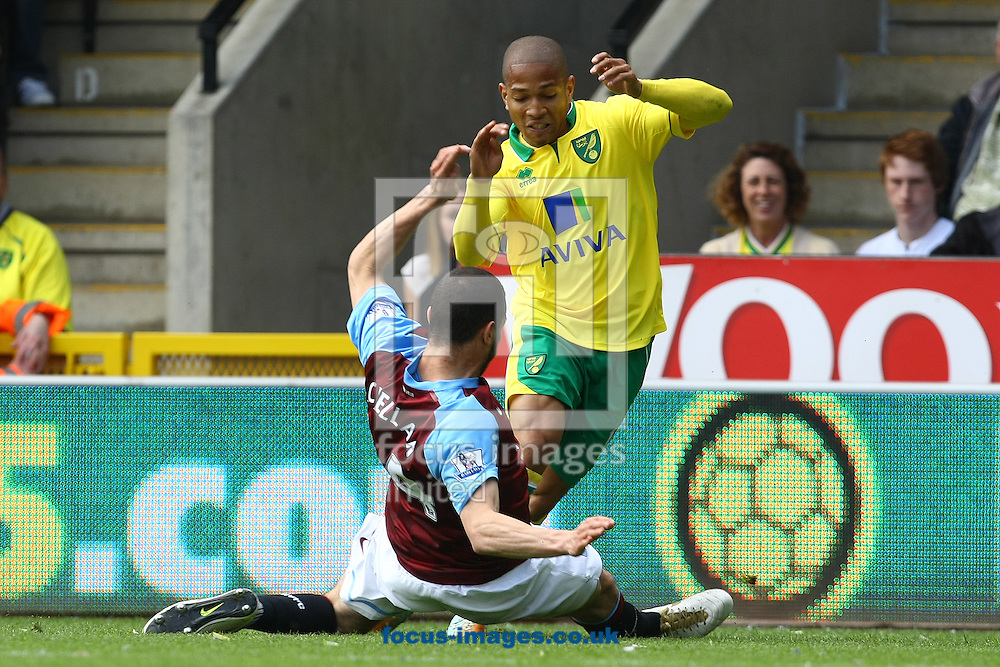 Picture by Paul Chesterton/Focus Images Ltd.  07904 640267.13/05/12.Carlos Cuéllar of Aston Villa and Simeon Jackson of Norwich in action during the Barclays Premier League match at Carrow Road Stadium, Norwich.