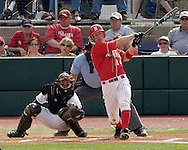Nebraska's Luke Gorsett drives the ball to left field against Kansas State's Adam Cowart.  Nebraska held on to be Kansas State 5-4 at Tointon Stadium in Manhattan, Kansas, April 1, 2006.