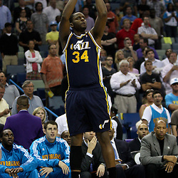 April 11, 2011; New Orleans, LA, USA; Utah Jazz small forward C.J. Miles (34) against the New Orleans Hornets during the first half at the New Orleans Arena.  Mandatory Credit: Derick E. Hingle