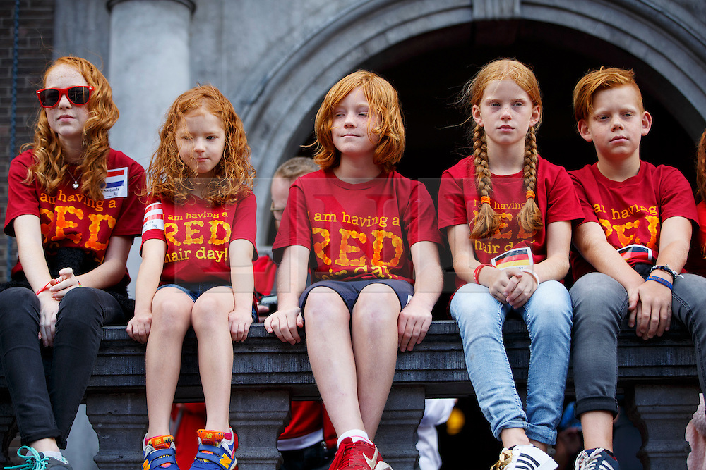 © Licensed to London News Pictures. 04/09/2016. Breda, The Netherlands. Thousands of redheads fill a Dutch city Breda to celebrate International Redhead Day event in The Netherlands on Sunday, 4 September 2016. Every year natural redheads from more than 80 countries come together at 'Roodharigendag' annual weekend long festival to celebrate their ginger genes. The event also holds the world record for the largest number of natural redheads being in one place. Photo credit: Tolga Akmen/LNP
