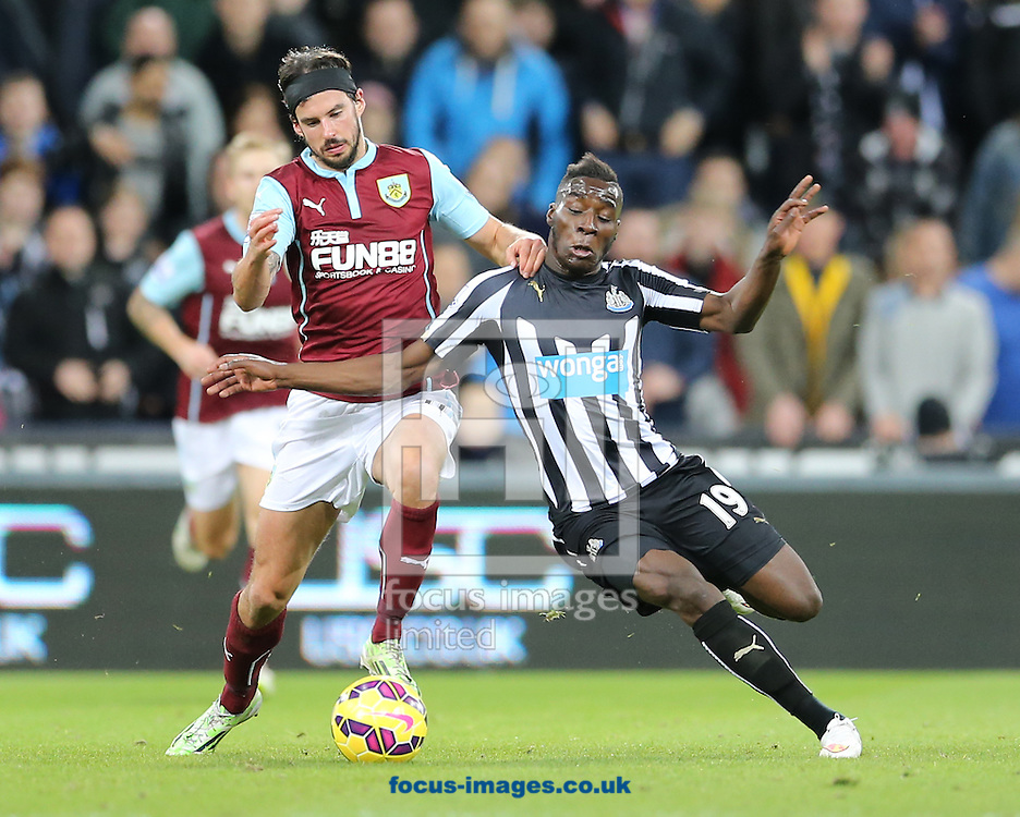 Massadio Haidara (r) of Newcastle United and George Boyd of Burnley during the Barclays Premier League match at St. James's Park, Newcastle<br /> Picture by Simon Moore/Focus Images Ltd 07807 671782<br /> 01/01/2015